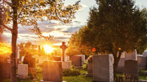 A sunset behind headstones