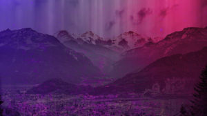 Ice capped mountains with a purple color
